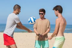 Young men playing volley ball in beach. Young men playing volley ball in the beach Stock Photography
