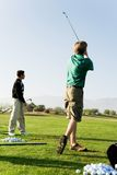 Young Men Practicing Golf Royalty Free Stock Images