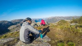 A couple cooking in the wilderness in Norway on the way to Trolltunga. royalty free stock images