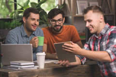 Young men programmers working together in the office Stock Images