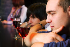 Young man relaxing in a night bar Stock Image