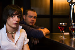 Young men relaxing in a bar. Stock Photos