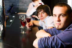 Young men relaxing in a bar. Royalty Free Stock Photos