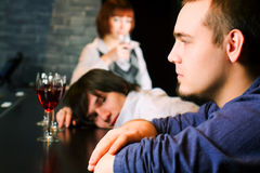 Young people relaxing in a night bar Royalty Free Stock Photography