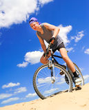 Young men  riding a bike Stock Image