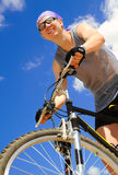 Young men  riding a bike Stock Photography