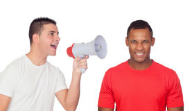 Young men screams to his angry friend through a megaphone. Isolated on a white background Stock Photos