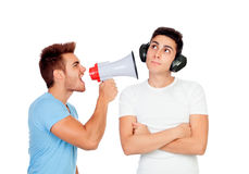 Young men screams to his friend through a megaphone. Isolated on a white background Royalty Free Stock Images