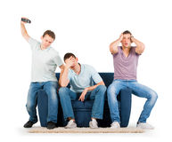 Young men sitting on a sofa disappointed Royalty Free Stock Photography