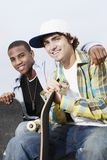 Young Men With Skateboards Stock Photos