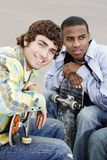 Young Men With Skateboards Stock Image