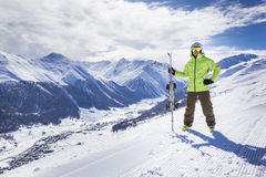 Young men with ski on a mountain winter resort Royalty Free Stock Photo
