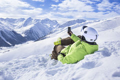 Young men with smartphone mountain winter resort Royalty Free Stock Photo