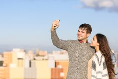 Young man and woman making selfie otdoors Stock Photography