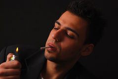 Young men smoking cigarette Royalty Free Stock Images