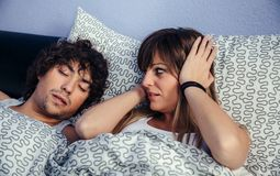Man snoring and his wife annoyed royalty free stock photo