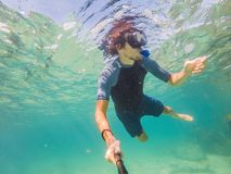 Young men snorkeling exploring underwater coral reef landscape background in the deep blue ocean with colorful fish and. Young man snorkeling exploring stock images