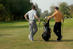 Young men standing in golf course Stock Photos