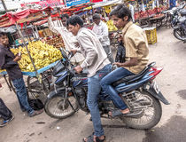 Young men on the streets of Hyderabad in India stock images