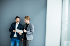 Young men with tablet. In the office Royalty Free Stock Images