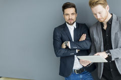 Young men with tablet Stock Images