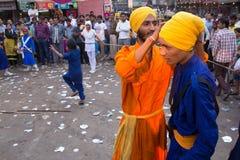 Young men taking part in Guru Nanak Gurpurab celebration in Delh Stock Photo
