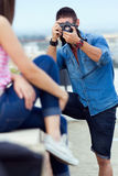 Young men taking photo of his girlfriend. Royalty Free Stock Photography