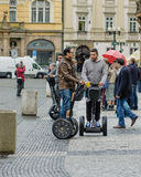 Young men traveling on the Segways in Prague Royalty Free Stock Photo