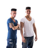 Young Men in Trendy Attire with Mohawk Hairstyles Stock Image