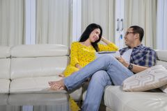Young man talking with his wife at home Stock Photo