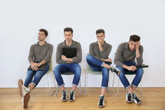 Young men waiting for job interview Royalty Free Stock Photos