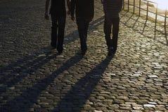 Young men walking stock photography