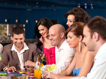 Young men and wemen playing blackjack Stock Image
