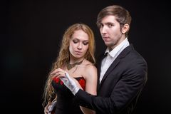 Young man in white gloves and blond woman Stock Image