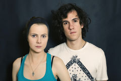 Young men and women on a black background Stock Images