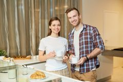 Young couple in the kitchen royalty free stock images
