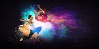Young modern ballet dancers in a jump. Mixed media stock photos