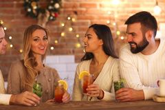 Young men and women drinking cocktail at party Royalty Free Stock Image