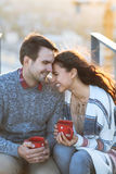Young man and woman embrace and having fun outdoors Royalty Free Stock Images