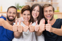 Young men and women giving a thumbs up Stock Photography
