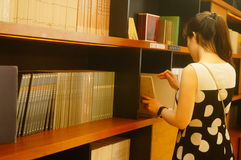 Young men and women in the library, reading. At the He Ningxiang museum. In Shenzhen, China stock photos