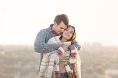 Young man and woman in love having fun outdoors royalty free stock photos