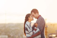 Young man and woman in love having fun outdoors royalty free stock image