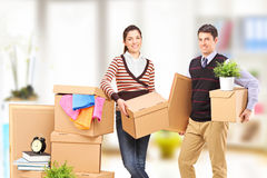 A young man and woman moving into an apartment Stock Images