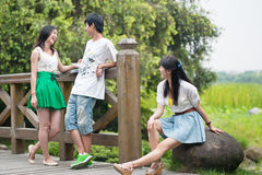 Young men and women in the outskirts of chat Stock Images