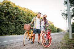 Young man and woman with retro bikes Royalty Free Stock Photo