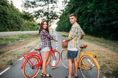 Young man and woman with retro bikes Stock Photo