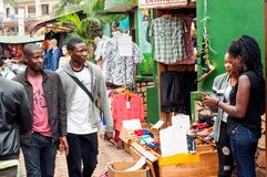 Shoppers in Pioneer Mall, Kampala, Uganda. Young men and women shopping and serving in Pioneer Mall, downtown Kampala, Uganda Royalty Free Stock Image