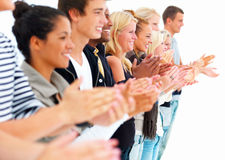 Young men and women standing and clapping hands Royalty Free Stock Image