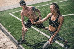 Man and woman stretching stock image